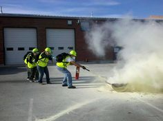 Littleton CERT Class - training with a partner to use a fire extinguisher
