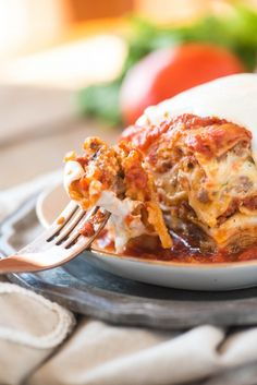 This easy classic lasagna recipe is million-dollar-good! Layers of marinara, Alfredo sauce, sausage, ricotta cheese, herbs and fresh mozzarella! No boil makes it great for busy nights. Veggie Recipes, Beef Recipes, Great Recipes, Dinner Recipes, Cooking Recipes, Healthy Recipes, Lasagna Recipes, Dinner Menu, Healthy Dinners