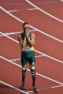 London 2012 Emotional Moments- Slideshow Day 8 | South Africa's double-amputee athlete Oscar Pistorius reacts after coming in second in the men's 400 heats. Pistorius made Olympic athletics history on Aug. 4 when he became the first double-amputee to compete in both the Olympics and Paralympics.  (Photo: Gabriel Bouys / AFP - Getty Images) #NBCOlympics