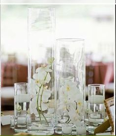 Wedding Flowers by Martin Roberts - for centerpieces but with purple orchids