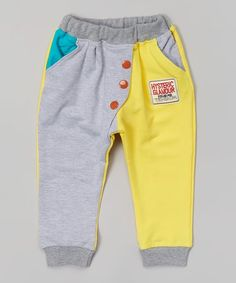 Soft cotton construction keeps little ones comfy and cozy, while the colorful pockets and buttons put the fun into function.