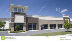 strip centers | Stitched panoramic of a shades of brown, upscale strip mall.