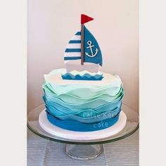 First birthday sail boat cake Ombré waves in pale green and blues surround the cake topped with a handmade sugar sail boat . Nautical Birthday Cakes, Nautical Cake, Baby Boy 1st Birthday, First Birthday Cakes, Bolo Fack, Boat Cake, Torta Baby Shower, Ocean Cakes, Cute Desserts