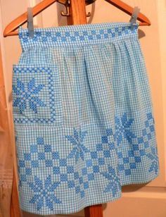 handiwork all in a days kitschy work ...  http://www.etsy.com/listing/93902960/vintage-apron-blue-gingham-star-vintage