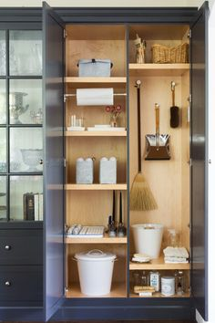 Stealth utility closet built into a wall of pantry shelving.