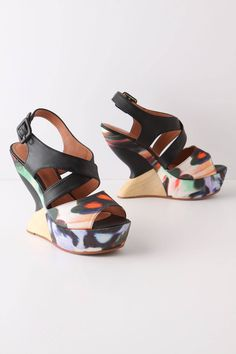something about these Kivi Wedges from Anthro ($258) makes me want to put on a dress and go on vacation
