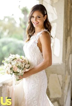 """""""No red roses,"""" Desiree Hartsock demanded of her floral arrangement. """"They're not my favorite."""" At her request, the bride walked down the aisle with gathering of ranunculus, peonies, and vines to fulfill her ideal bouquet."""
