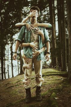 seeks up behind him guess who only she has a dozen hands all over him, camping in forest, woods,  Creative Photography by Julia Presslauer