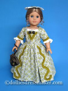 American Girl doll Elizabeth in gown with fringe trim. Pinner cap and reticule complete her ensemble $94.95