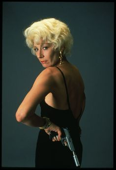 Anjelica Huston in The Grifters. You really don't get much badder than this. (Bonus: She played the hero's MOTHER...)