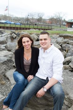 A couple sitting on the rocks by a park. Copyright Photographics Solution 2013