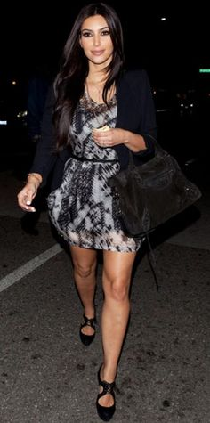 Look of the Day › June 4, 2011 WHAT SHE WORE The bride-to-be exited an L.A. eatery in a printed minidress, cuffed blazer and a Balenciaga tote. WHY WE LOVE IT Kim Kardashian looked polished in all-over black and white-from her manicure down to her lace-up pumps!