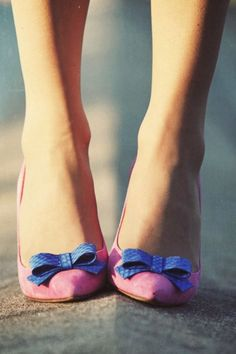 Shoes with pink leather heels, all tied up with blue leather bows: cute as can be...