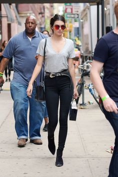 Because she knows full well you can't go wrong in a T-shirt and skinny jeans, she simply tops things off with a studded leather belt and mirrored sunglasses.   - MarieClaire.com