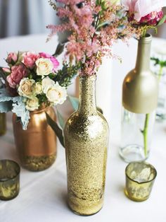 Empty Glass Bottles Fill In As Gorgeous Wedding Centerpieces