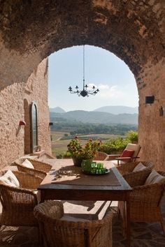 Italian country home with a gorgeous view from the dining terrace.