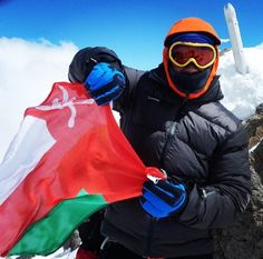 """Anas Al Balusi, Omani adventurer who follows adorable rule """" Climb mountain, walk lands, & dive oceans. Be young, wild, and free"""" He is one of the most famous adventurers in Oman. This photo shows when Anas rose Oman's flag on the highest point in Europe. Looking forward for our meeting today with Anas wink emoticon #elbrus #Russia #mountain #7summits #summit #mountainclimbing #mountaineering #oman #muscat #arab #pictureoftheday #amazing #beautiful…"""