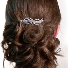 Create a stunning #updo with this classic Swarovski crystal bow comb. This #hair slide can be used to keep hair out of the eyes, secure a hairstyle or it can be used for purely ornamental reasons. #wedding #hair #hairstyles #accessories