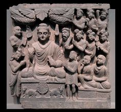 """ภาพแกะหินพระประวัติพระพุทธเจ้า """"ปฐมเทศนา"""", ปลายศตว. 2, สกุลคันธาระ • """"First Sermon at the Deer Park in Sarnath"""" • Four Scenes from the Life of the Buddh • Kushan dynasty, late 2nd to early 3rd century AD, Gandhara."""