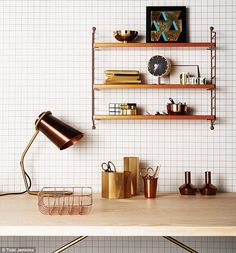 On table, from left: COPPER AND BRASS TABLE LAMP, £450, The Conran Shop. copper DESK TRAY, £32, House Doctor. HEXAGONAL BRASS CONTAINERS, £38.50  each, Holly's House. GOLD-PLATED SCISSORS, from £45 each, The New Craftsmen. COPPER BEAKER, £11.40, VG&P. COPPER CANDLESTICKS, £5.99 each, H&M. WOOD AND BRASS TABLE, £1,755, Another Country. copper SHELVING UNIT, £110, Ivor Innes.  Top shelf: BRASS BOWL, £115, Skandium. ARTWORK, £90, Darkroom. Middle shelf: NOTEBOOKS, from £20 each, Ben Pentreath…
