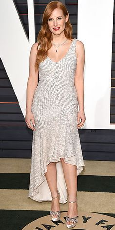 All the Oscars Dresses You Didn't See | JESSICA CHASTAIN | The actress swapped her classic navy Givenchy Haute Couture design for an edgier white sequin bias-cut number, worn to the Vanity Fair party with Jimmy Choo sandals and a Piaget necklace.