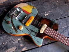 """Gate Guitar Custom #003"" from Spalt Instruments. Thin guitar is partly made from old gate. Pickups tops are from colored bones and it is Lindy Fralin pickups. See more here: http://www.spaltinstruments.com/instruments/gate-guitars"