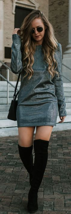 New Years Eve outfit styled with silver shimmer dress, black over the knee boots
