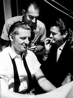Jerry Lee Lewis visits Nashville for a recording session at Sun Studio on Sept. The session was directed by Sam, right, and Jud Phillips. Also looking on is sax player Boots Randolph, one of the musicians on the session.