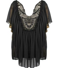 Regal Chiffon Top: Features a plunging frill-trimmed neckline filled with a mesmerizing embellished crochet applique, dramatic fluttery cape sleeves for a modern silhouette, sheer mesh upper backside, and expertly gathered chiffon fabric throughout to finish.
