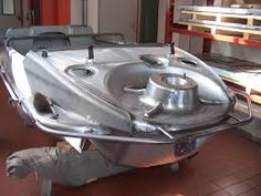 A VW Type 166 Schwimmwagen hull assembly striped down to metal while under restoration
