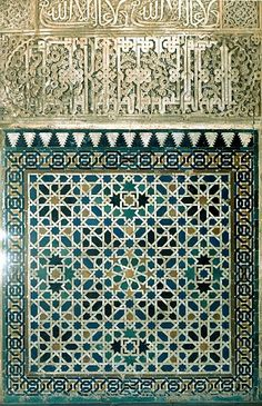 Image SPA 1307 featuring decorated area from the Alhambra, in Granada, Spain, showing Geometric PatternFloriated Arabesque and Calligraphy using ceramic tiles, mosaic or pottery and stucco or plasterwork.