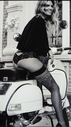 Sexy lady on Vespa