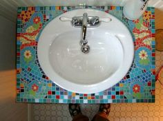 I absolutely love this mosaic counter top. Would be great in the kids bathroom.