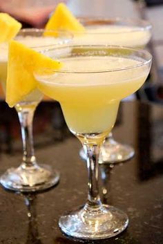 The Best Pineapple Margaritas Recipe: tequila, pineapple juice, lime juice, triple sec, granulated white sugar, cointreau, crushed ice, lime slices
