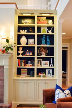Built in cabinets with furniture feet.  Toe kick recessed back to help keep dust from collecting below.