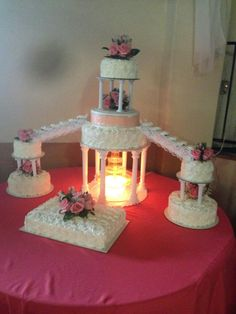 Quinceañera cake.  8 tears. White rosette whip cream cakes. Water fountain on lower plates supporting three tears.