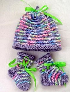 Easy to knit, this set of cap and booties will keep a precious newborn warm. Simple knit and purl stitches create the raised ridges. Knit in the round with an I-cord topper.