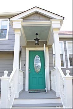 Update that front door with a punch of color.  I chose turquoise and love it with my gray and white painted house.