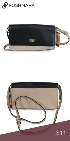 Women s Solid Clutch Taupe Black - Merona Features of Women s Solid Clutch  Taupe Black - Merona e97e007398e99