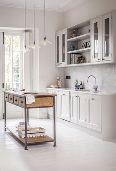 This beautiful light-filled Georgian townhouse in central London was redesigned with a Scandinavian flair … love the results. Building on its original architecture, the interiors are a perfect mix of old and new, with its beautiful floor-to-ceiling windows, off-white painted wood flooring in the living room & kitchen, and eye-catching light fixtures .. and love the calming neutral palette throughout | Design …