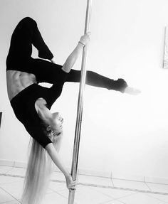 I love that pole fitness has been enjoying more mainstream success lately. It's like all of a sudden people realized how athletic you have to be in order to do any kind of pole work at all. Look at this girl and tell me she is NOT fit as a fiddle--and if you don't think so, I dare you to try this move for yourself!