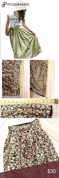 Long Gold Sequin Swing Skirt XL Long Gold Sequin Swing Skirt. Great for Valentine's Day Prom or any other special occasion. See measurements in photo. XL sequins are delicate so handle with care. Skirt flares for extra room in hips. Lined Skirts