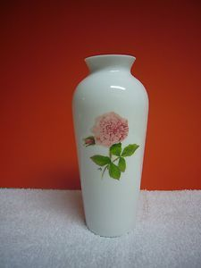 "Beautiful decorative collectible Marjolein Bastin white glass vase with pink rose.  6"" tall and 2 1/2"" in diameter at its widest point."
