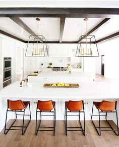 Paint color is Extra White by Sherwin-Williams, Countertops are Statuario Nuvo by Caesarstone, Cabinets are by Benjamin Blackwelder Cabinetry