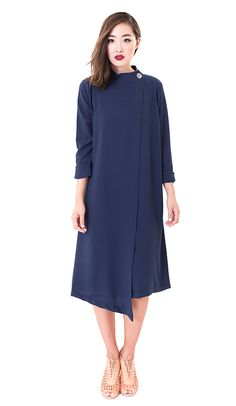Modest long sleeve midi length aysemterical hem dress