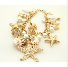 (Our min order is $10 you can mix order)Hot Wholesale fashion tide wind ocean cloud starfish shell exquisite pendant bracelet US $3.80