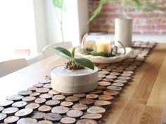 How to make a rustic-style table runner using branches. >> http://www.hgtv.com/shows/danmade/how-tos/how-to-make-a-wood-slice-table-runner?soc=pinterest