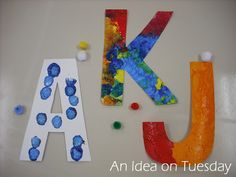 decorate large cardboard letters weekly to illustrate the letter of the week while providing an open