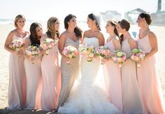 These blush tones and slightly sparkly bridesmaid dresses are stunning! Plus, the MOH stands out in the most perfect way. Photo: The Studio Photographers // Featured: The Knot Blog