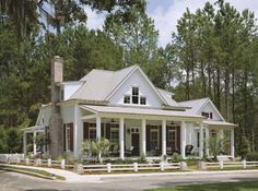 Eplans Cottage House Plan - Cottage Of The Year from The Southern Living. It has a guest cottage semi-attached! Pretty cool!!!